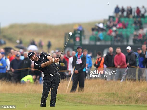 US golfer Dustin Johnson plays his approach shot to the 7th green during his third round on day three of the 2014 British Open Golf Championship at...