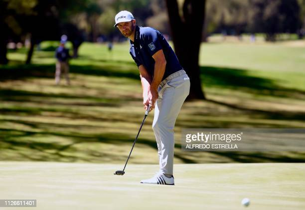 US golfer Dustin Johnson plays his shot at green 10 during the first round of the World Golf Championship in Mexico City at Chapultepec's Golf Club...
