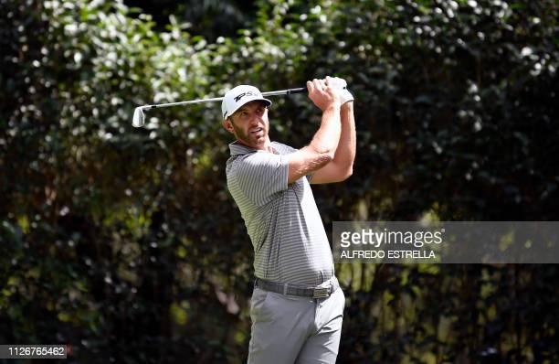 US golfer Dustin Johnson plays his shot at the tee three during the second round of the PGA World Golf Championship at Chapultepec's Golf Club in...
