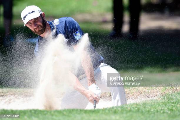US golfer Dustin Johnson plays his shot from a bunker on green one during the fourth and last round of the World Golf Championship in Mexico City on...