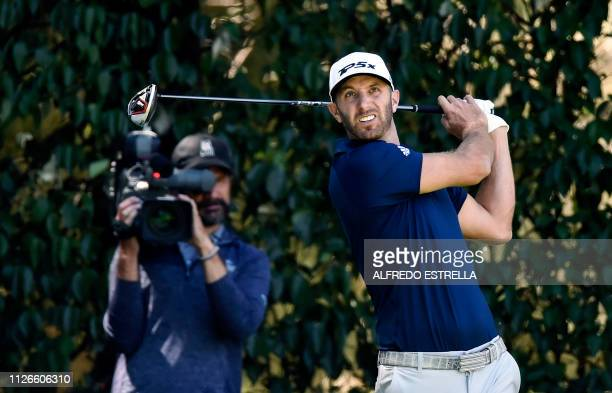US golfer Dustin Johnson plays his shot from the 11th tee during the first round of the World Golf Championship in Mexico City on February 21 2019...