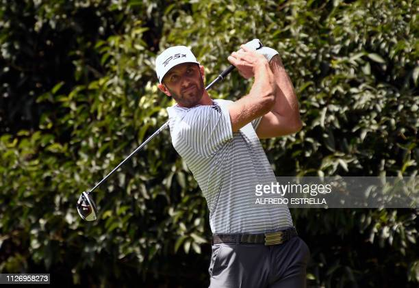 US golfer Dustin Johnson plays his shot on the tee of the 2nd hole during the third round of the PGA World Golf Championship at Chapultepec's Golf...
