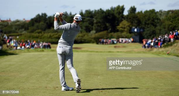 US golfer Dustin Johnson plays to the par 3 4th hole during his opening round on the first day of the Open Golf Championship at Royal Birkdale golf...