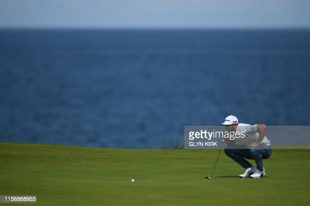 US golfer Dustin Johnson prepares to putt on the 5th hole during the third round of the British Open golf Championships at Royal Portrush golf club...