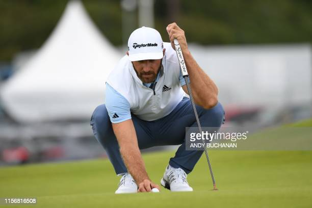 US golfer Dustin Johnson putts at the 3rd green during the third round of the British Open golf Championships at Royal Portrush golf club in Northern...