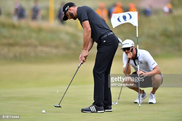 US golfer Dustin Johnson putts on the 14th green during a practice round at Royal Birkdale golf course near Southport in north west England on July...