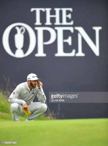 US golfer Dustin Johnson putts on the 18th green during the second round of the British Open golf Championships at Royal Portrush golf club in...