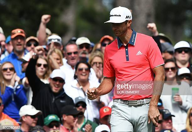 US golfer Dustin Johnson reacts after putting on the 6th green during Round 4 of the 80th Masters Golf Tournament at the Augusta National Golf Club...