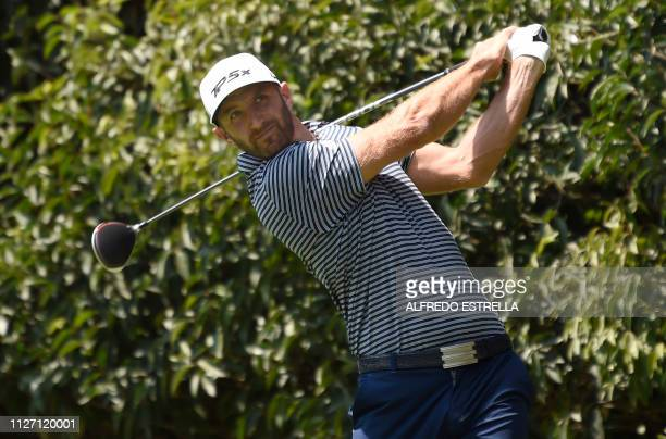 US golfer Dustin Johnson shoots at the tee 2 during the third round of the World Golf Championship at Chapultepec's Golf Club in Mexico City on...
