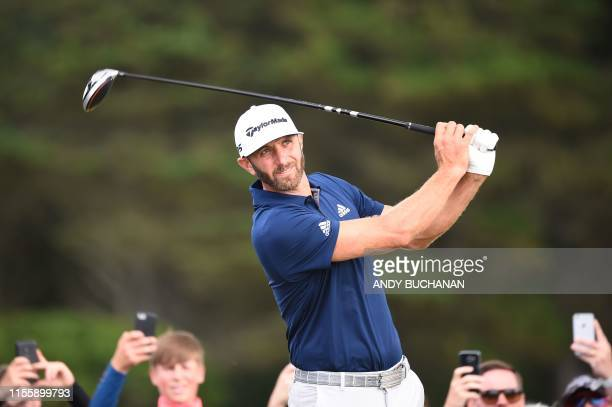US golfer Dustin Johnson tees off from the 12th hole during a practice session at The 148th Open golf Championship at Royal Portrush golf club in...