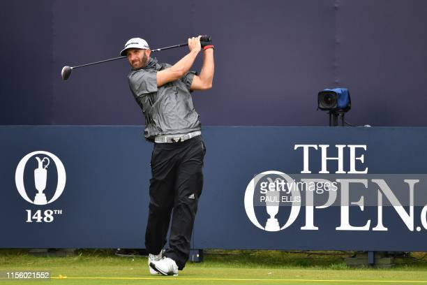 US golfer Dustin Johnson tees off from the first hole during a practice session at The 148th Open golf Championship at Royal Portrush golf club in...