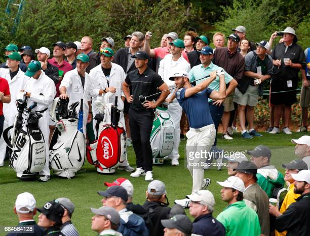 PGA golfer Dustin Johnson tees off on the 14th hole during the first day of practice for the 2017 Masters Tournament on April 3 at Augusta National...