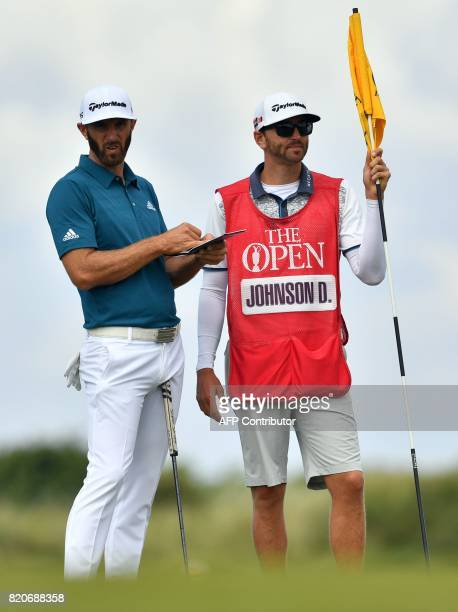 US golfer Dustin Johnson waits with his brother and caddie Austin on the 10th tee during his third round on day three of the Open Golf Championship...