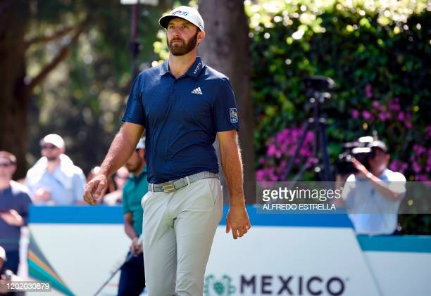 US golfer Dustin Johnson walks after his tee shot from the 14th tee during the first round of the World Golf Championship at Chapultepec's Golf Club...