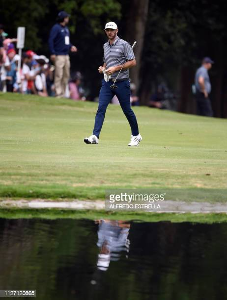 US golfer Dustin Johnson walks at the farway of the hole 6 during the third round of the World Golf Championship at Chapultepec's Golf Club in Mexico...