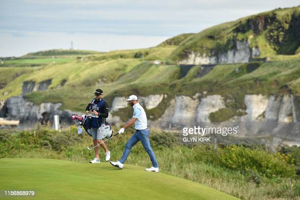 US golfer Dustin Johnson walks onto the 5th green during the third round of the British Open golf Championships at Royal Portrush golf club in...
