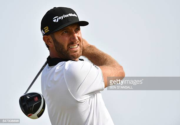 US golfer Dustin Johnson watches his drive from the 13th tee during his first round on the opening day of the 2016 British Open Golf Championship at...