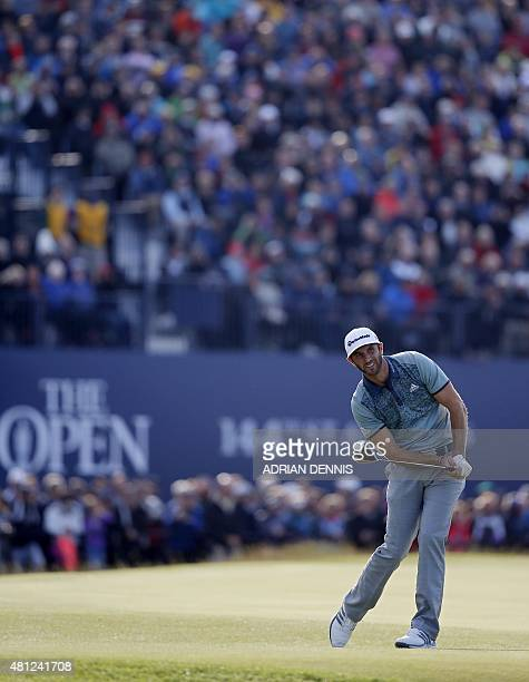 US golfer Dustin Johnson watches his drive from the 18th tee during the completion of his second round 69 on day three of the 2015 British Open Golf...