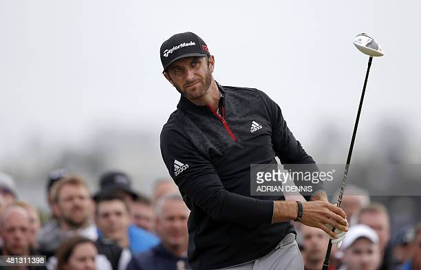 US golfer Dustin Johnson watches his drive from the 4th tee during his third round on day four of the 2015 British Open Golf Championship on The Old...