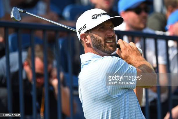 US golfer Dustin Johnson watches his iron shot from the 13th tee during a practice session at The 148th Open golf Championship at Royal Portrush golf...