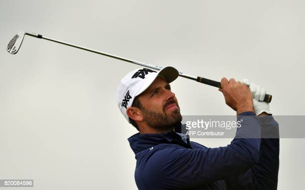 US golfer Dustin Johnson watches his iron shot from the 4th tee during his second round on day two of the Open Golf Championship at Royal Birkdale...