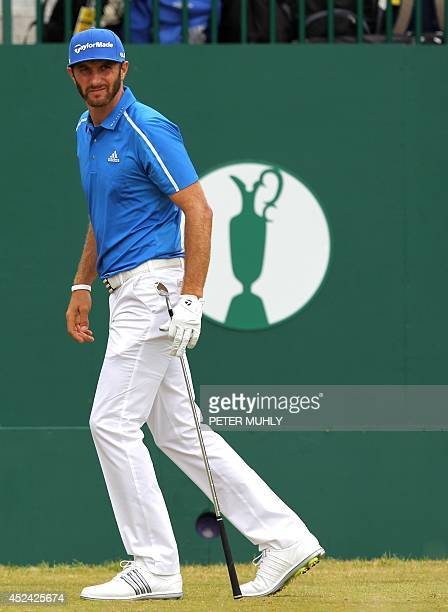 US golfer Dustin Johnson watches his shot from the 1st tee during his fourth round on the final day of the 2014 British Open Golf Championship at...