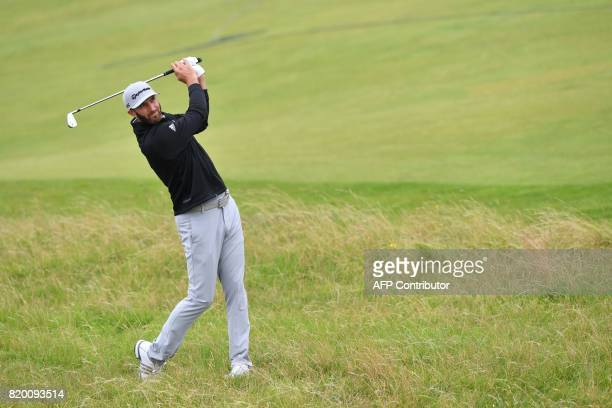 US golfer Dustin Johnson watches his shot from the rough on the 6th hole during his second round on day two of the Open Golf Championship at Royal...