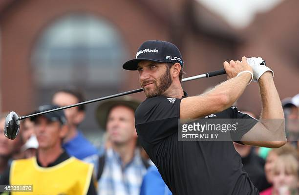 US golfer Dustin Johnson watches his shot from the17th tee during his third round 71 on day three of the 2014 British Open Golf Championship at Royal...