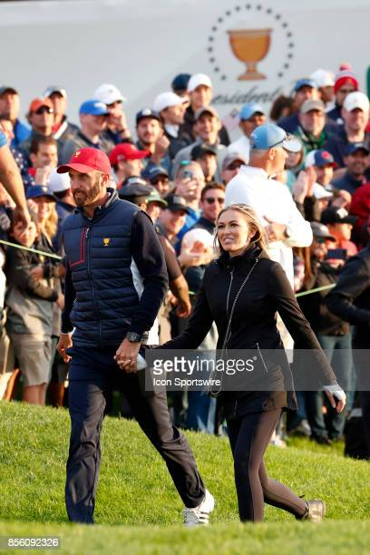 USA golfer Dustin Johnson with his fiancé Paulina Gretsky walk around the 18th green during the third round of the Presidents Cup at Liberty National...