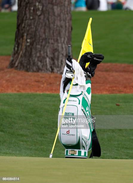 PGA golfer Dustin Johnson's bag sits near the 16th green during the first day of practice for the 2017 Masters Tournament on April 3 at Augusta...