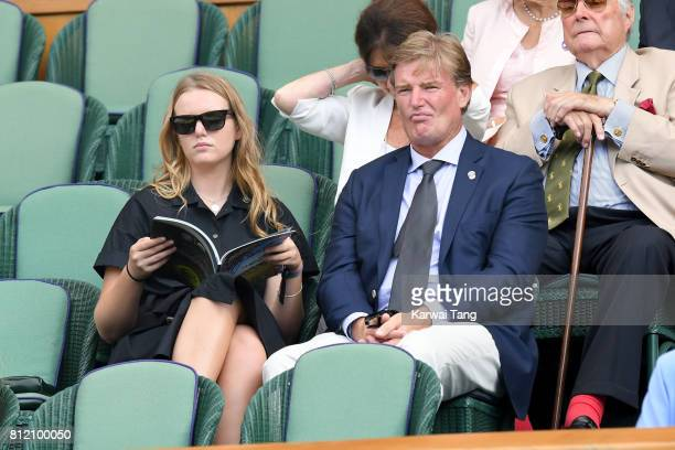Golfer Ernie Els and guest attend day seven of the Wimbledon Tennis Championships at the All England Lawn Tennis and Croquet Club on July 10 2017 in...