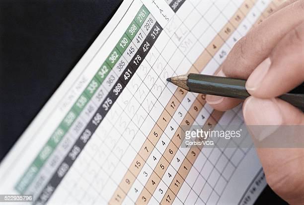 Golfer Filling in Scorecard