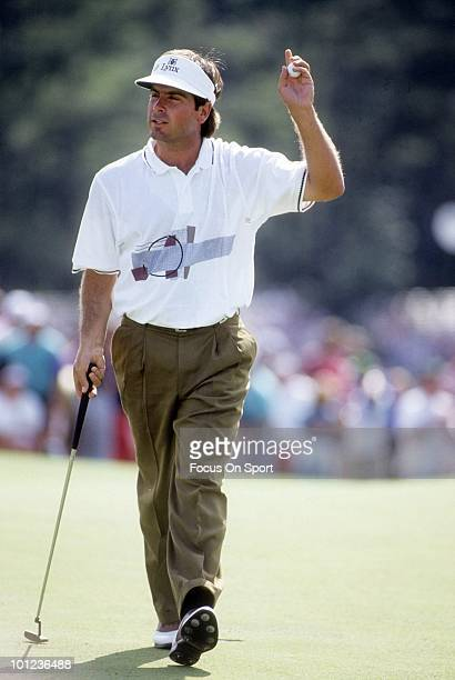 Golfer Fred Couples in this portrait waiving to the crowd during play April 12 1992 at the Masters at Augusta National Golf Club in Augusta Georgia...