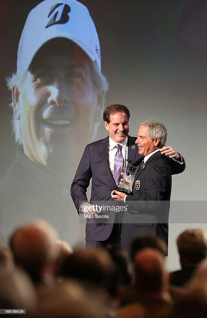 Golfer Fred Couples stands with Jim Nantz during his induction into the World Golf Hall of Fame on May 6, 2013 at the World Golf Village in St Augustine, Florida.