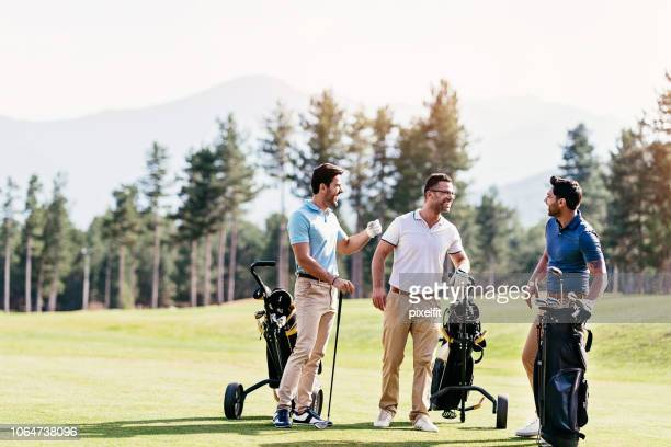 golfer friends - golf stock pictures, royalty-free photos & images