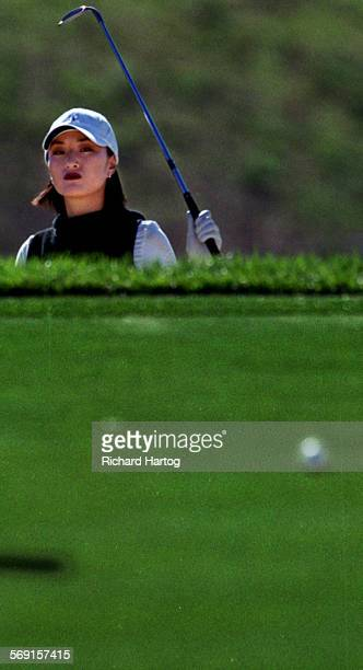 Golfer Grace Park finds herself up to her neck in trouble as she watches her ball roll after hitting out of the bunker on the 5th hole during the...