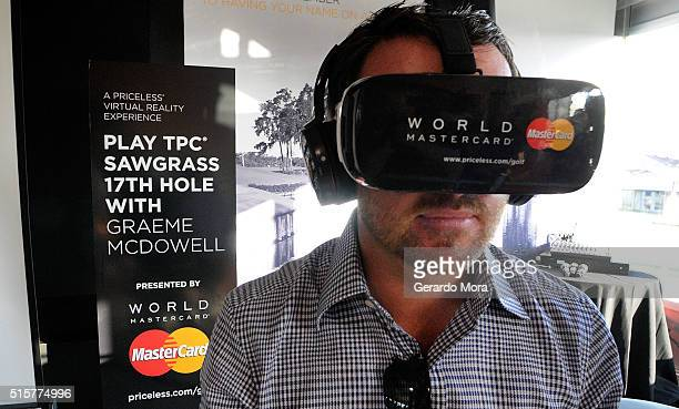 TOUR golfer Graeme McDowell demonstrates MasterCard's latest payment enabled solutions including virtual reality at the Arnold Palmer Invitational...