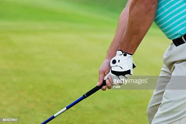 Golfer Gripping Golf Club