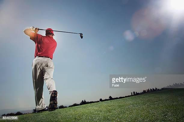Golfer Hitting Ball Down Fairway