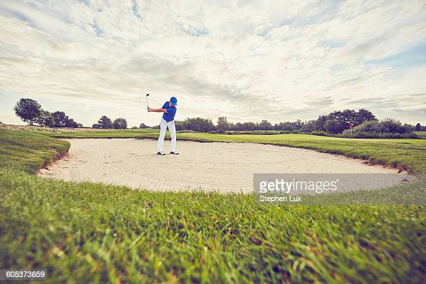 golfer hitting ball in sand trap, korschenbroich, dusseldorf, germany - putting stock pictures, royalty-free photos & images