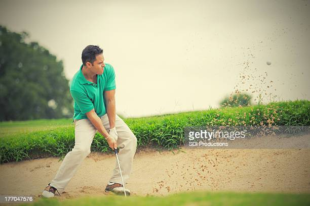 golfer hitting his golf ball out of sand trap - bunker stock pictures, royalty-free photos & images