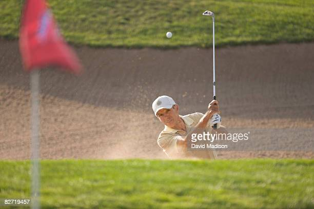 golfer hitting out of bunker or sand trap. - sand trap stock pictures, royalty-free photos & images