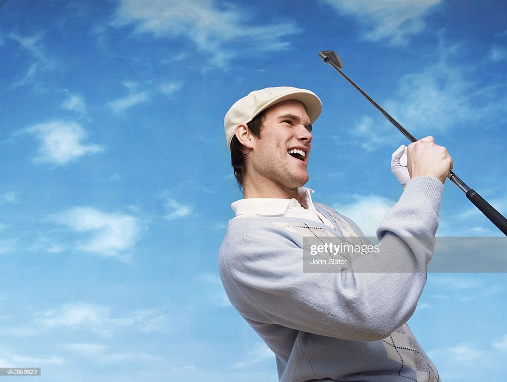 Golfer Holding a Golf Club and Cheering : Stock Photo