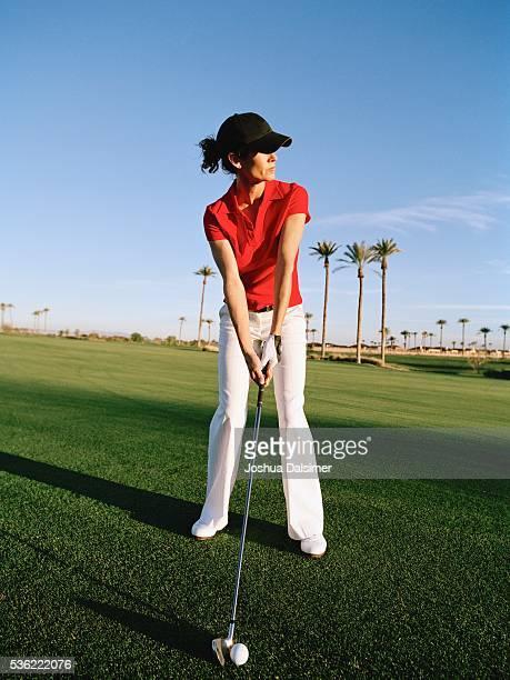Golfer holding golf club