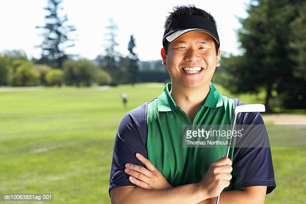 golfer holding putter, portrait - golfer stock pictures, royalty-free photos & images