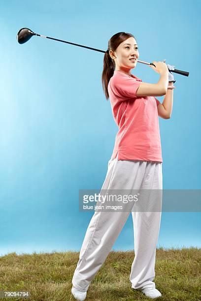 A golfer in mid swing.