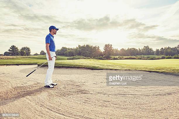 golfer in sand trap, korschenbroich, dusseldorf, germany - sand trap stock pictures, royalty-free photos & images