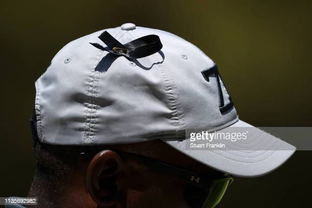 0821231dc5a43 A golfer is seen wearing a black ribbon on his hat to commemorate the  victims of
