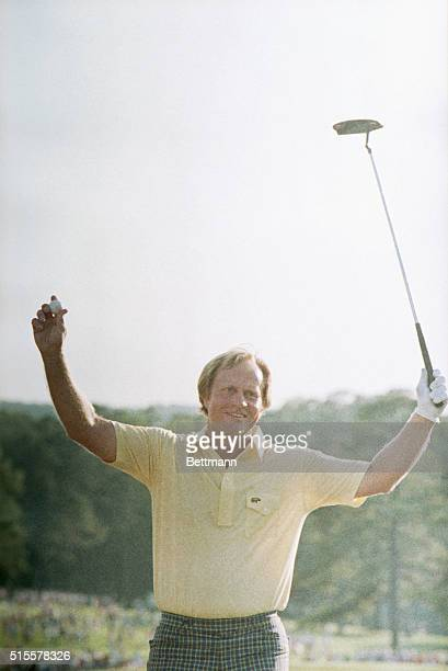 Golfer Jack Nicklaus raises his club and ball in victory after winning the Masters Tournament in 1986.