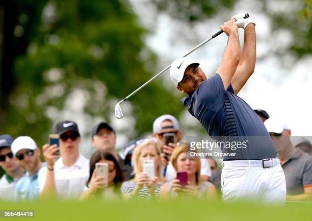 Golfer Jason Day follows through on his drive from the eighth tee box during fourth round action of the Wells Fargo Championship on Sunday, May 6,...